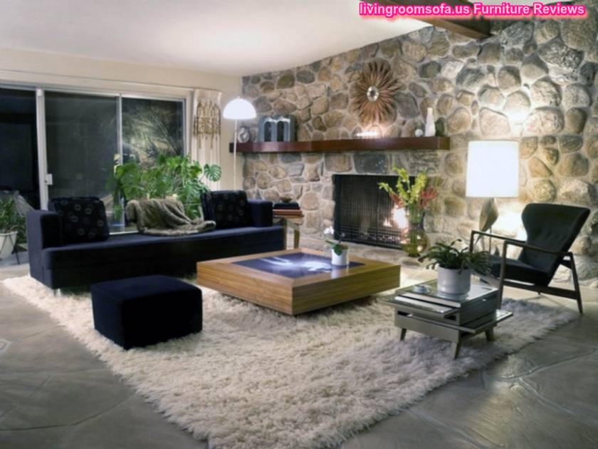 Excellent Living Room Furniture Design Ideas With Fireplace And Black Sofa On Cream Fur Rug Also Stone Walls As Well As Delightful Lighting