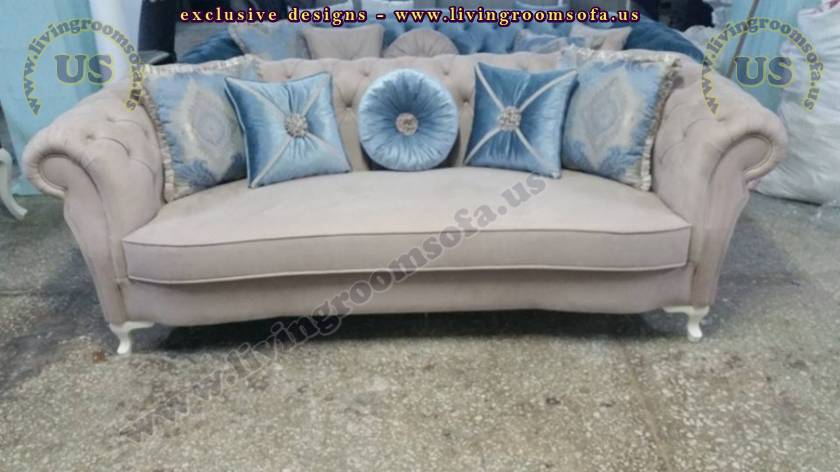 brown fabric chesterfield with blue pillows