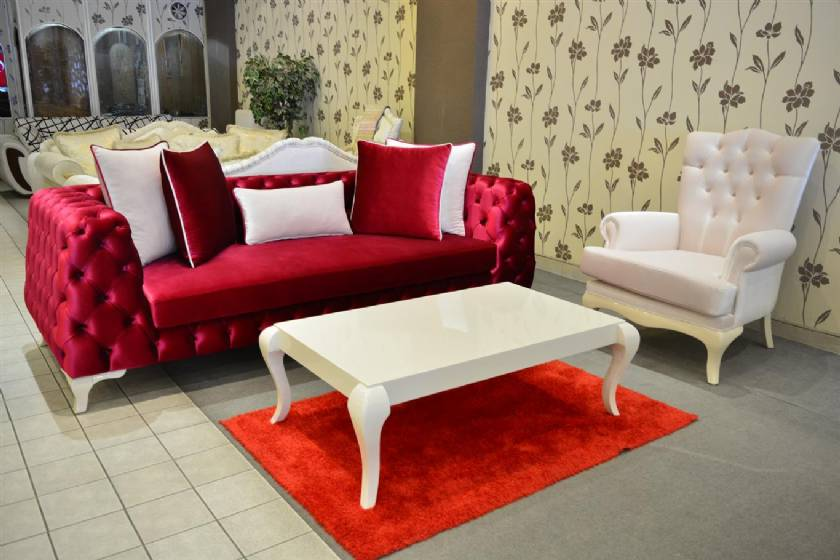Newton red velvet chesterfield sofa and white velvet armchair
