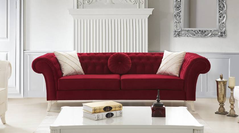 Red velvet chesterfield sofa loveseat with rounded pillow