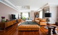 Brown leather chesterfield sofa and pouf luxury leather living room