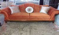 coral velvet chesterfield sofa and silver pillows