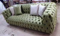 green fabric chesterfield sofa