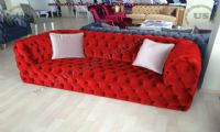 red velvet decorative chesterfield couch