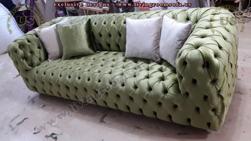 green fabric chesterfield sofa